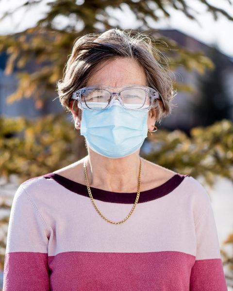 Linda Wilton standing outdoors wearing face mask